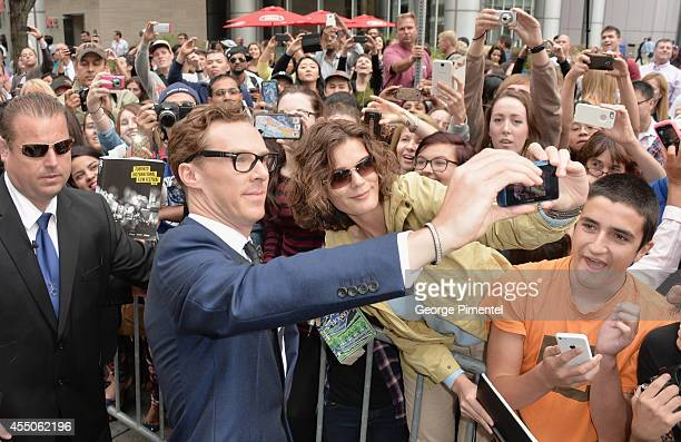 Actor Benedict Cumberbatch takes a selfie with a fan at The Imitation Game premiere during the 2014 Toronto International Film Festival at Princess...