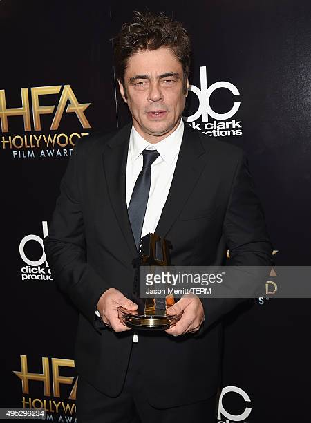 Actor Benicio del Toro winner of the Hollywood Supporting Actor Award for 'Sicario' poses in the press room during the 19th Annual Hollywood Film...