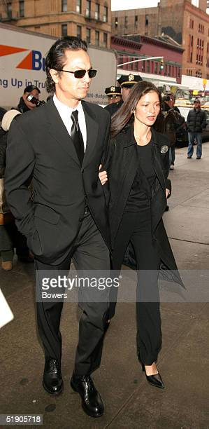 Actor Benjamin Bratt and Jill Hennessy attend the funeral for Jerry Orbach at Riverside Chapel December 31 2004 in New York City