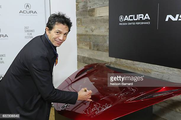 Actor Benjamin Bratt of 'Dolores' signs the hood of a 2017 Acura NSX at the Acura Studio during Sundance Film Festival 2017 on January 21 2017 in...