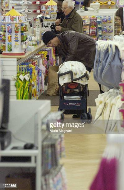Actor Benjamin Bratt walks with his baby girl Sophia Rosalinda Bratt while shopping along with his wife actress Talisa Soto December 19 2002 in New...