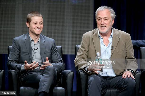 Actor Benjamin McKenzie and producer Bruno Heller speak onstage at the 'Gotham' panel during the FOX Network portion of the 2014 Summer Television...