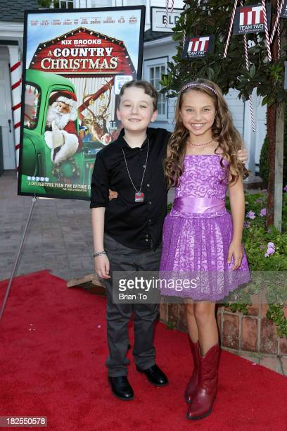 Actor Benjamin Stockham and actress Caitlin Carmichael attend A Country Christmas Los Angeles Special Screening at The DeMille Theatre on September...