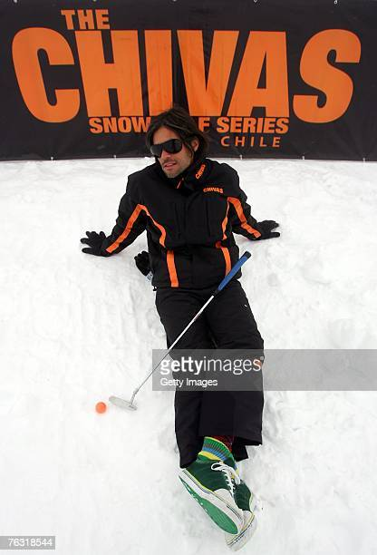 Actor Benjamin Vicuna of Argentina poses with a golf club during the Chivas Snow Golf Championship Chile at La Parva Ski Resort on August 24 2007 in...