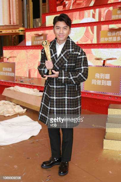 Actor Benjamin Yuen Waiho poses with the trophy during the TVB Anniversary Gala at TVB City on November 19 2018 in Hong Kong China