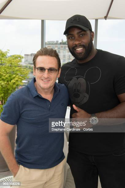 Actor Benoit Magimel and World Judo Champion Teddy Riner attend the 2018 French Open - Day Thirteen at Roland Garros on June 8, 2018 in Paris, France.