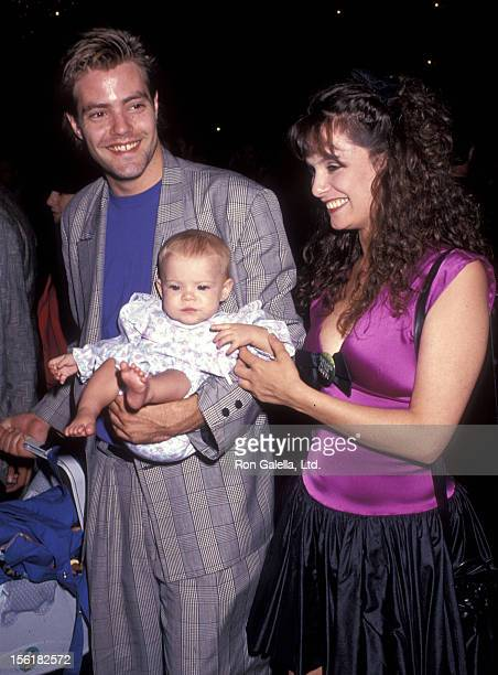 Actor Bentley Mitchu wife Samara Mitchum and daughter Alexanne Mitchum attend 'The Man in the Moon' West Hollywood Premiere on October 2 1991 at DGA...