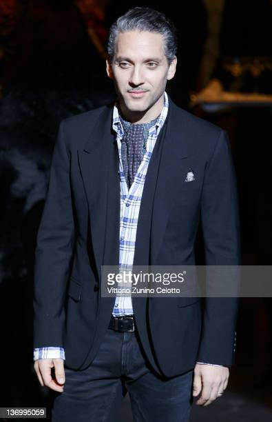 Actor Beppe Fiorello poses on the runway prior the Dolce Gabbana fashion show as part of Milan Fashion Week Menswear Autumn/Winter 2012 on January 14...