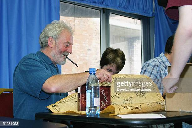 Actor Bernard Hill is seen autograohing a map of 'Middle Earth' for a fan at The Fellowship Festival 2004 aimed at J R R Tolkien fans at Alexandra...