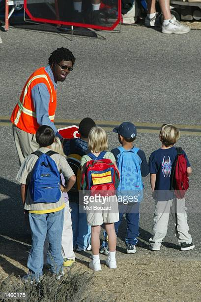 Actor Bernie Mac films a cameo role for the upcoming movie 'Charlie's Angels 2' in which he plays a crossing guard who gets attacked by a group of...