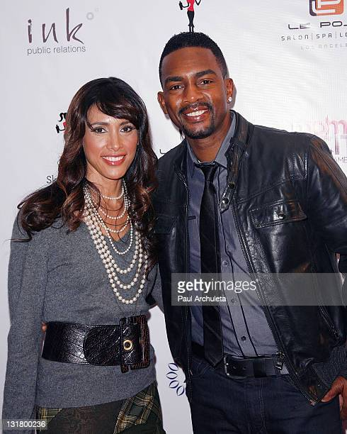 Actor Bill Bellamy and his wife Kristen Baker attend the Moms And The City launch party at Le Posh Salon on February 7 2011 in Los Angeles California