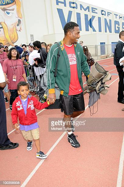 Actor Bill Bellamy arrives with son Baron at the NFL Players Premiere League Flag Football Tournament and Skills Challenge on May 23 2010 in Santa...