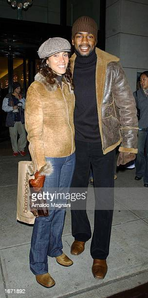 Actor Bill Bellamy with his wife Christina Bellamy leave Barneys November 30 2002 in New York City