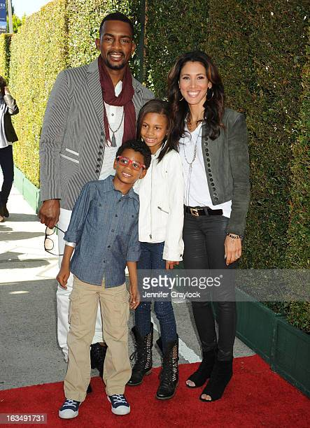 Actor Bill Bellamy with wife Kristen Baker Bellamy and children attend the John Varvatos 10th Annual Stuart House Benefit held at John Varvatos Los...
