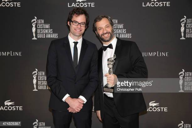 Actor Bill Hader and honoree Judd Apatow pose with the Distinguished Collaborator award during the 16th Costume Designers Guild Awards with...