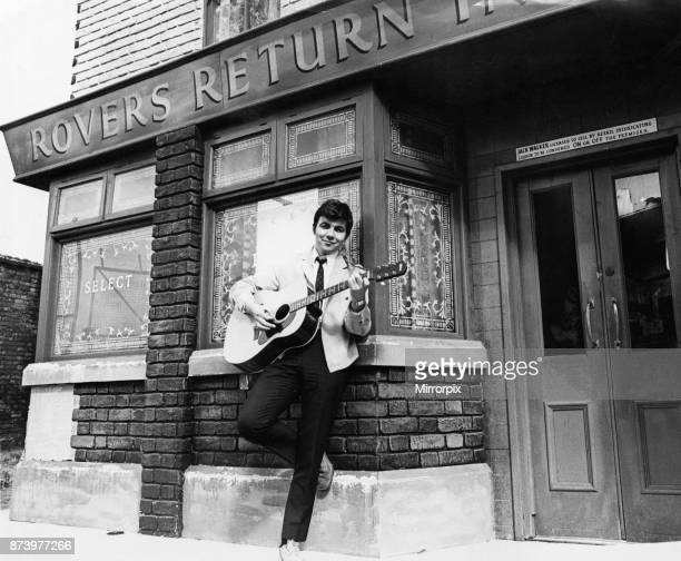 Actor Bill Kenwright who plays Gordon Clegg in the television soap opera Cornation Street poses in the famous street with his guitar shortly before...