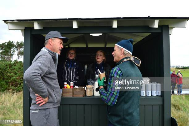 Actor Bill Murray and Businessman Peter Jones inside the quarter way house with workers during Day two of the Alfred Dunhill Links Championship at...