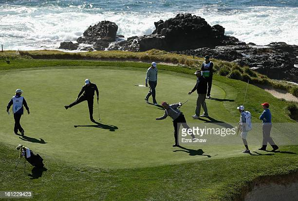 Actor Bill Murray and playing partner DA Points do a dance after Points made a birdie putt on the seventh hole during the third round of the ATT...
