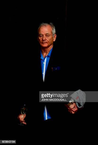 US actor Bill Murray arrives with the Silver Bear for Best Director and a glass of wine for a press conference following the awards ceremony of the...
