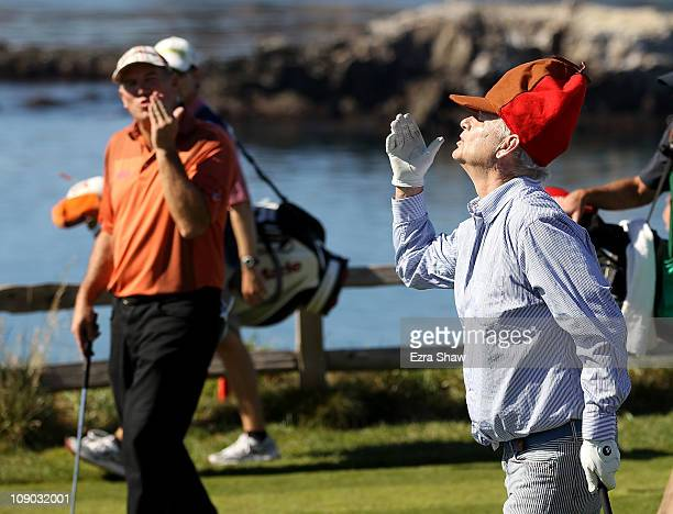 Actor Bill Murray blows kisses to his playing partner DA Points after they teed off on the 7th hole during the third round of the ATT Pebble Beach...