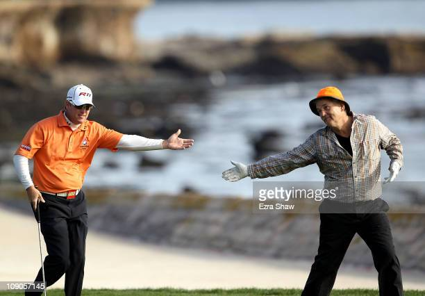 Actor Bill Murray bows to his playing partner and tournament winner, D.A. Points, as they walk up the 18th fairway during the final round of the AT&T...