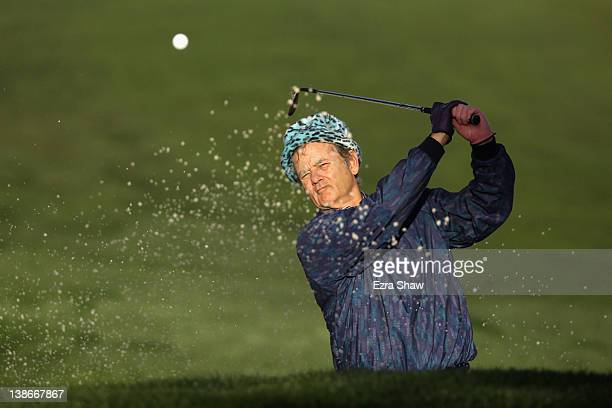 Actor Bill Murray hits of a bunker on the tenth hole during the second round of the ATT Pebble Beach National ProAm at the Monterey Peninsula Country...
