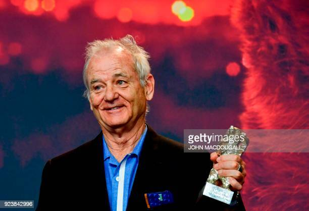 TOPSHOT US actor Bill Murray holds the Silver Bear for Best Director award as he arrives for a press conference following the awards ceremony of the...