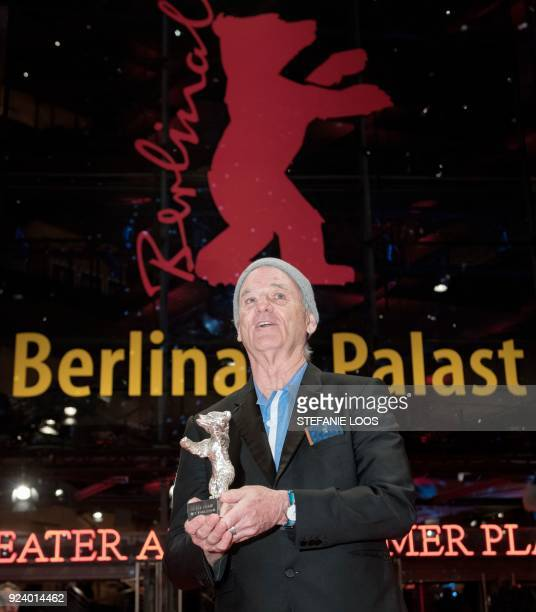 US actor Bill Murray holds the Silver Bear for Best Director award he received on behalf of Wes Anderson for the movie 'Isle of Dogs' at the end of...