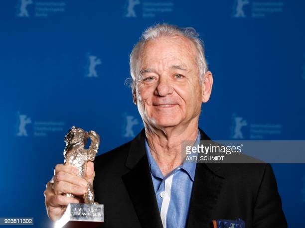 US actor Bill Murray holds the Silver Bear for Best Director award received on behalf of Wes Anderson for the movie Isle of Dogs during the awards...