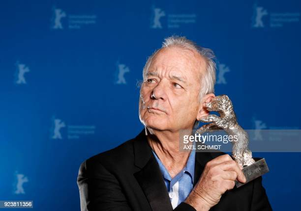 TOPSHOT US actor Bill Murray holds the Silver Bear for Best Director award received on behalf of Wes Anderson for the movie 'Isle of Dogs' during the...