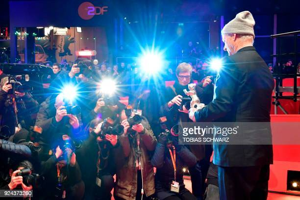 US actor Bill Murray holds the Silver Bear for Best Director award received on behalf of Wes Anderson for the movie Isle of Dogs at the end of the...