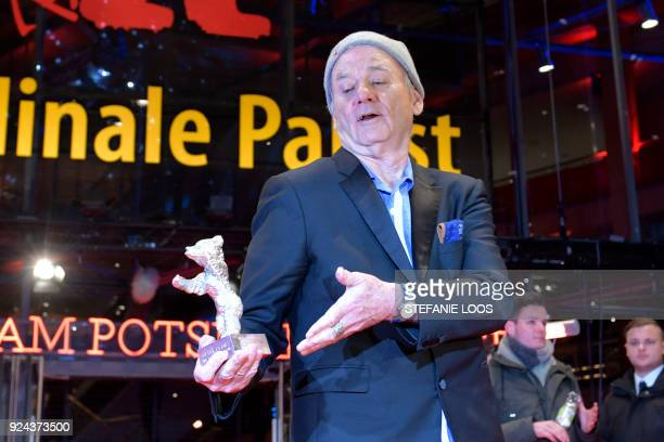 US actor Bill Murray holds the Silver Bear for Best Director award received on behalf of Wes Anderson for the movie 'Isle of Dogs' at the end of the...