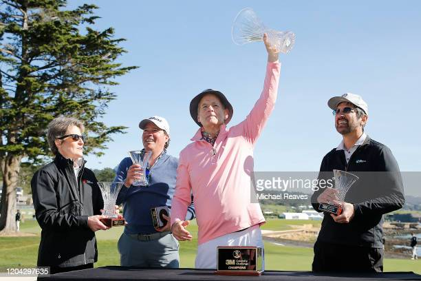 Actor Bill Murray holds up the 3M Celebrity Challenge trophy after winning prior to the ATT Pebble Beach ProAm at Pebble Beach Golf Links on February...