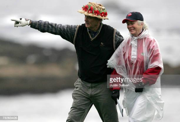 Actor Bill Murray jokes with volunteer course worker Linda Nash on the 4th tee of Spyglass Hill Golf Course during the first round of the AT&T Pebble...