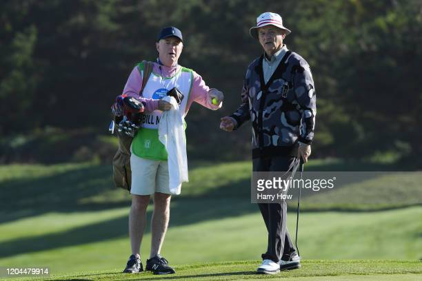 Actor Bill Murray looks over a putt with his caddie on the second green during the during the first round of the ATT Pebble Beach ProAm at Spyglass...