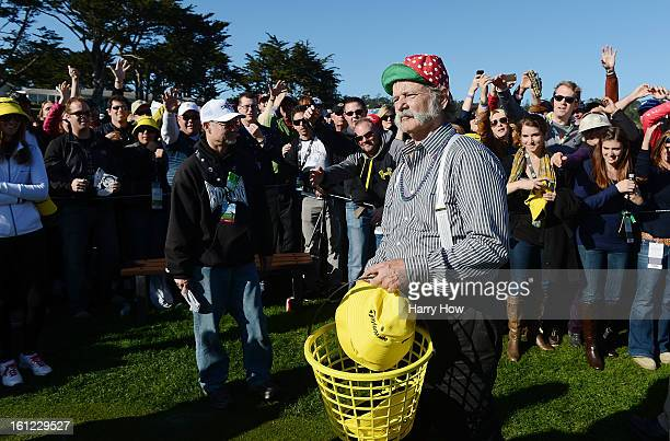 Actor Bill Murray passes caps to fans on the 17th hole during the third round of the ATT Pebble Beach National ProAm at Pebble Beach Golf Links on...