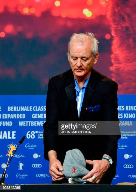 US actor Bill Murray plays with the Silver Bear for Best Director award during a press conference following the awards ceremony of the 68th edition...