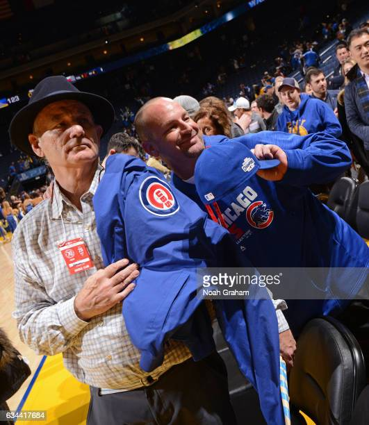 Actor Bill Murray poses for a photo with a Chicago Cubs fan after the Chicago Bulls game against the Golden State Warriors on February 8 2017 at...
