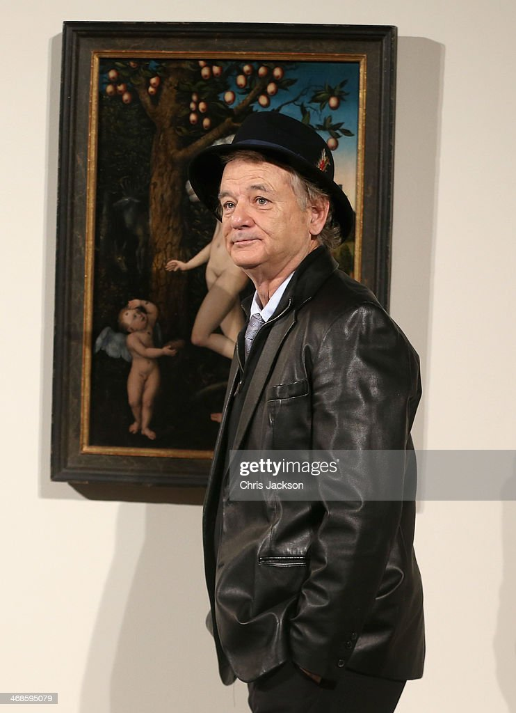Actor Bill Murray poses in front of the painting 'Cupid Complaining to Venus' by Lucas Cranach the Elder as he attends a photocall for 'The Monuments Men' at The National Gallery on February 11, 2014 in London, England. The painting was once part of Adolf Hitler's private collection.