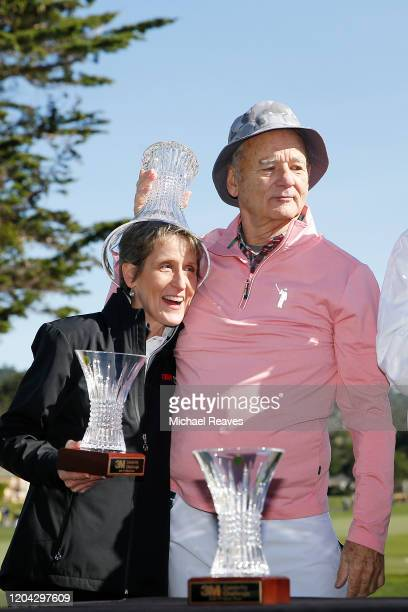 Actor Bill Murray puts the trophy on 3M Senior Vice President of Corporate Affairs Denise Rutherford's head after the 3M Celebrity Challenge prior to...