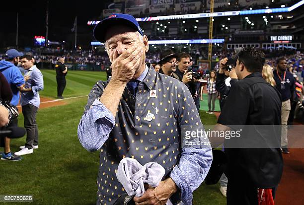 Actor Bill Murray reacts on the field after the Chicago Cubs defeated the Cleveland Indians 8-7 in Game Seven of the 2016 World Series at Progressive...