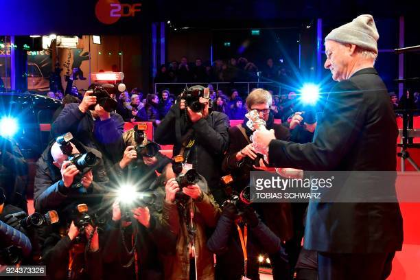 US actor Bill Murray shows the Silver Bear for Best Director award received on behalf of Wes Anderson for the movie Isle of Dogs at the end of the...
