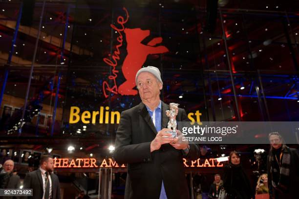 US actor Bill Murray shows the Silver Bear for Best Director award received on behalf of Wes Anderson for the movie 'Isle of Dogs' at the end of the...