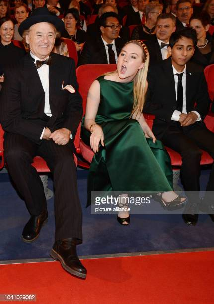 US actor Bill Murray sits Irish actress Saoirse Una Ronan as they attend the premiere of 'The Grand Budapest Hotel' during the 64th annual Berlin...