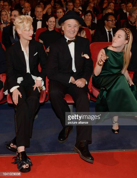 US actor Bill Murray sits next to British actress Tilda Swinton and Irish actress Saoirse Una Ronan as they attend the premiere of 'The Grand...