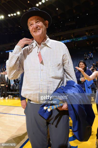 Actor Bill Murray smiles and walks off the court after the Chicago Bulls game against the Golden State Warriors on February 8 2017 at ORACLE Arena in...