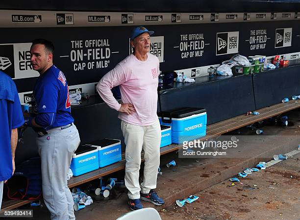 Actor Bill Murray spends a few minutes in the Chicago Cubs dugout after the game against the Atlanta Braves at Turner Field on June 11 2016 in...