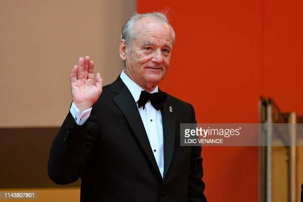 """Actor Bill Murray waves as he arrives for the screening of the film """"The Dead Don't Die"""" during the 72nd edition of the Cannes Film Festival in..."""
