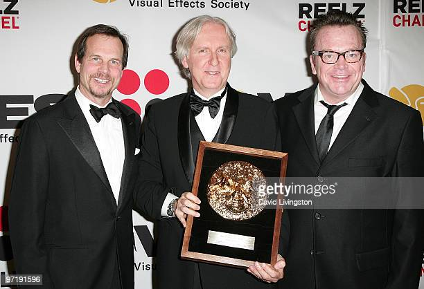 Actor Bill Paxton director and VES Lifetime Achievement Award recipient James Cameron and actor Tom Arnold pose in the press room at the 8th Annual...