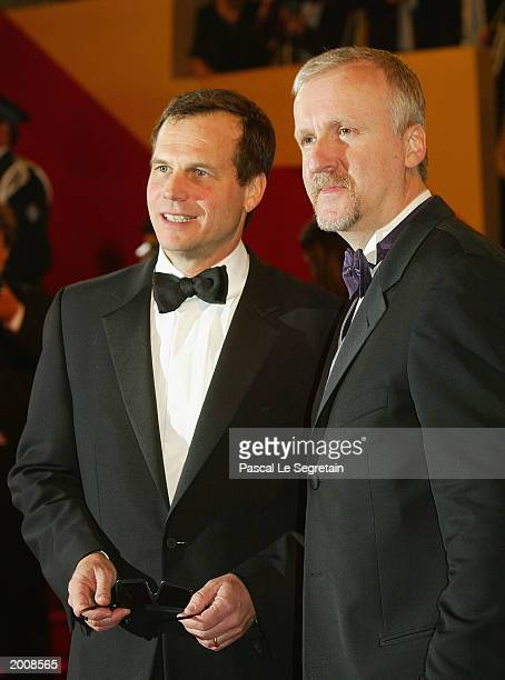 """Actor Bill Paxton with Director James Cameron arrive for the screening of the film """"Ghosts of the Abyss"""" at the Palais des Festivals during the 56th..."""